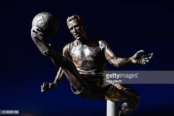 The statue of former Arsenal player Dennis Bergkamp is seen prior to the Barclays Premier League match between Arsenal and Swansea City at the...