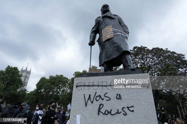 The statue of former British prime minister Winston Churchill is seen defaced with the words was a racist written on it's base in Parliament Square...