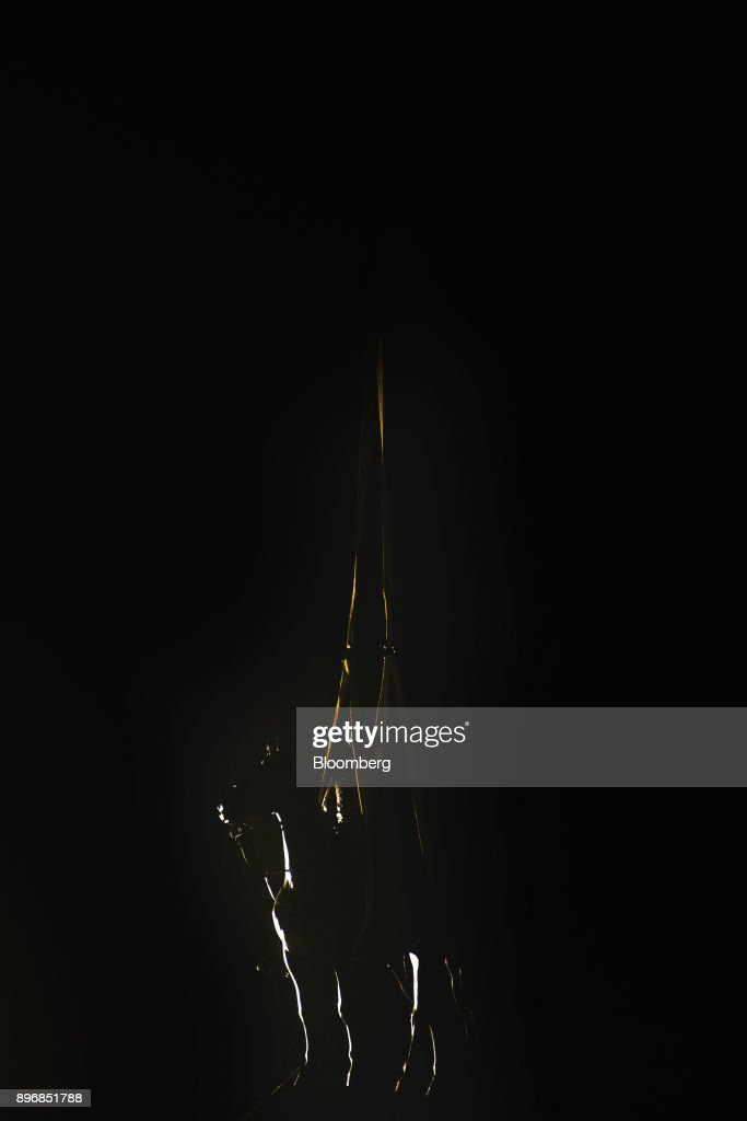 The statue of General Nathan Bedford Forrest is silhouetted while being removed from a park at night in Memphis, Tennessee, U.S., on Wednesday, Dec. 20, 2017. The City Council voted unanimously on Wednesday to sell two Memphis parks where Confederate statues were located. The parks were sold to Greenspace Inc. for $1,000 each, according to The Commercial Appeal. Photographer: Houston Cofield/Bloomberg via Getty Images