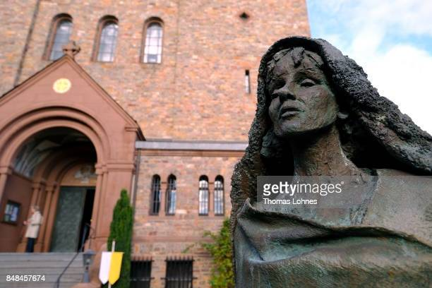 The statue of Hildegard von Bingen pictured in front of the abbey 'St Hildegard' after the annual procession during the Catholic Hildegard Pilgrimage...