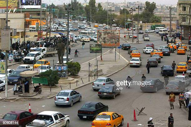 The statue of Iraqi Turkmen leader Abdullah Awchi adorns a central isle as traffic drives past in the center of the northern oil-rich city of Kirkuk,...