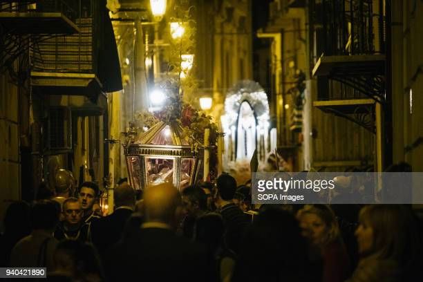 The statue of Jesus in a coffin and the Holy Mary advance through the narrow streets of Vucciria neighbourhood followed by christian believers On the...