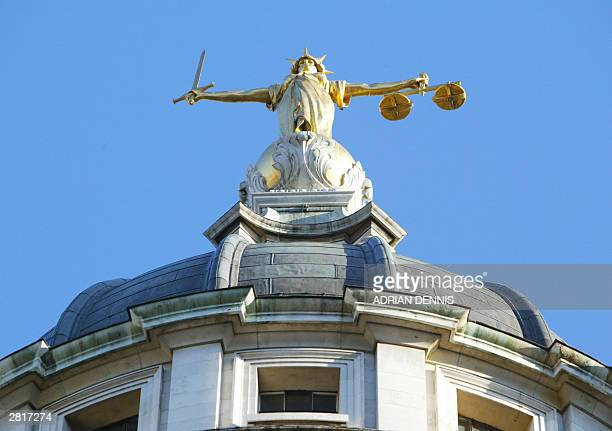 The statue of justice stands on the copula of the Old Bailey courthouse after Ian Huntley was sentenced to two life terms in prison for murdering...