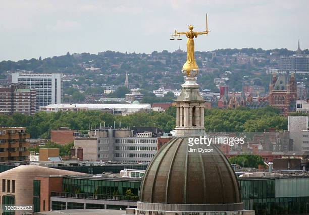 The statue of Lady Justice is pictured atop the Old Bailey against a backdrop of North London on August 3 2010 in London England The Central Criminal...
