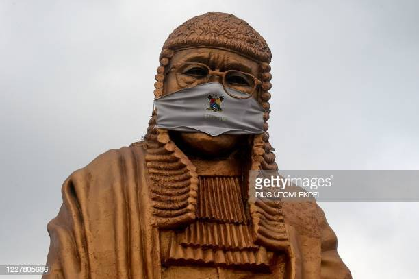 The statue of late lawyer and rights activist Gani Fawehinmi wears a face mask at the Liberty Park at Ojota in Lagos, on July 27, 2020. - The 34-feet...