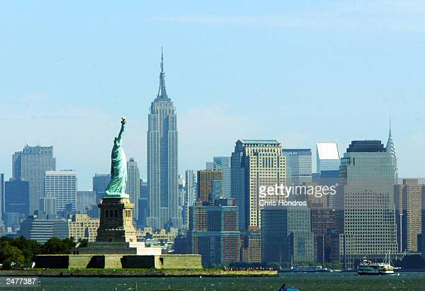 The Statue of Liberty appears before Manhattan's skyline September 9 2003 in New York City