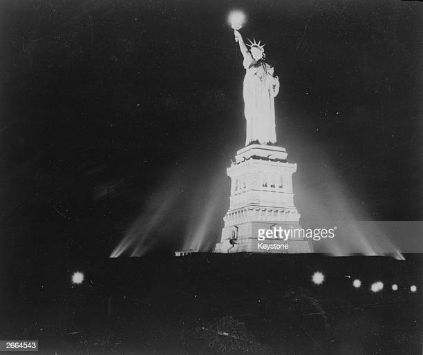 The Statue of Liberty in New York lit up for the first time since the attack on Pearl Harbour