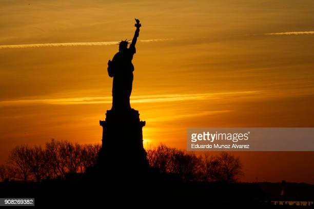 The Statue of Liberty is pictured from Liberty State Park on January 21 2018 in Jersey City New Jersey The iconic landmark was closed yesterday as...