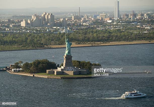 The Statue of Liberty is seen in this aerial photograph over New York City September 13 2016 / AFP / SAUL LOEB