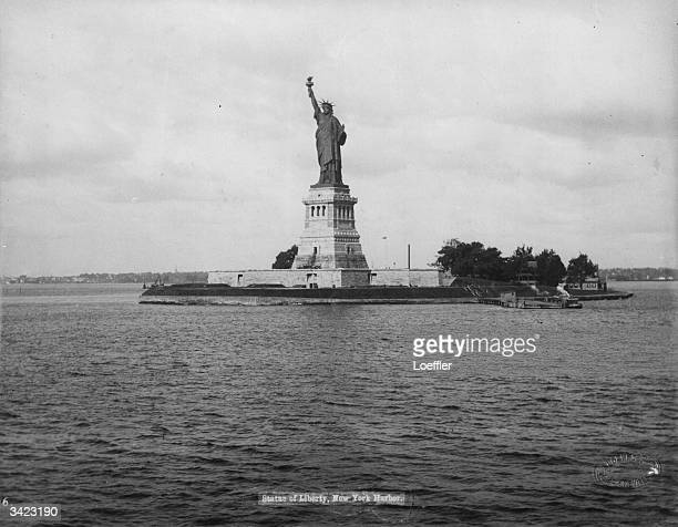 The statue of Liberty on Liberty Island in New York harbour Designed by the French sculptor Frederick Bartholdi the statue was presented to the...