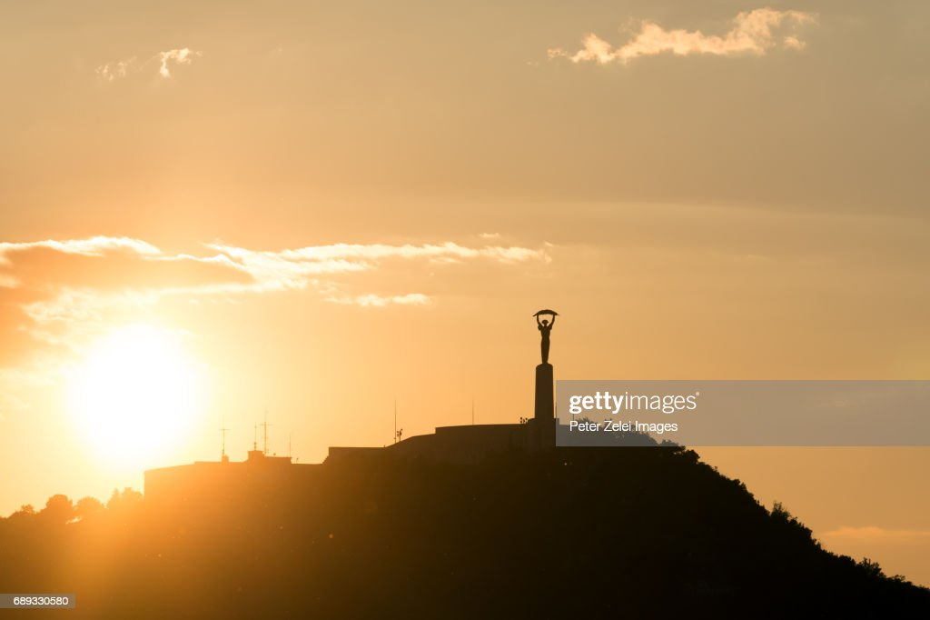 The Statue of Liberty on the Gellert Hill, Budapest, Hungary, at sunset : Stock Photo