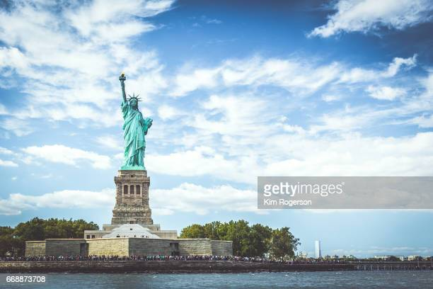 the statue of liberty on the island - statue of liberty stock pictures, royalty-free photos & images