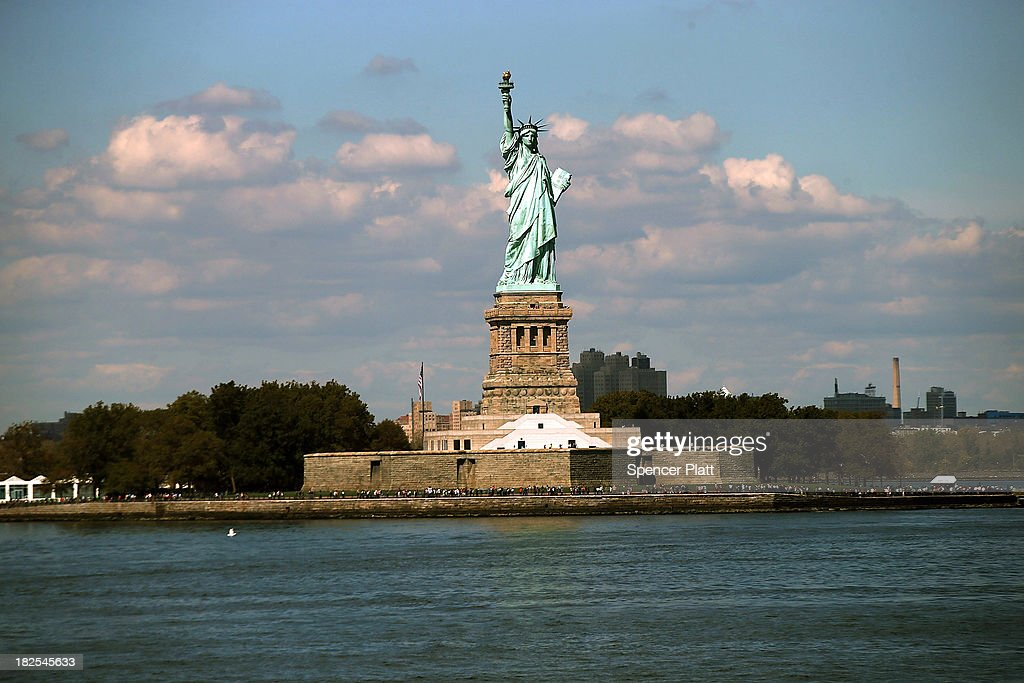 The Statue of Liberty, one of New York's premiere tourist attractions, is viewed from the Staten Island Ferry on September 30, 2013 in New York City. If Congress fails to pass a budget, the U.S. government would be forced to shut down at midnight on Monday. One of the results of a goverment shutdown would be the closing of all national parks including the Statue of Liberty and Ellis Island.