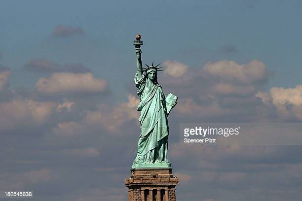 The Statue of Liberty one of New York's premiere tourist attractions is viewed from the Staten Island Ferry on September 30 2013 in New York City If...
