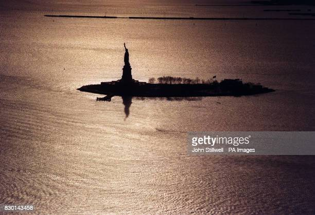 The Statue of Liberty standing on Ellis Island, New York  News Photo