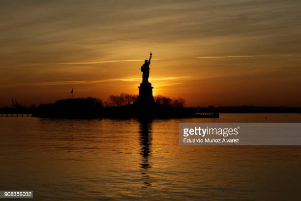 The Statue of Liberty stands in the harbor seen from Liberty State Park on January 21, 2018 in Jersey City, New Jersey. The iconic landmark remains...