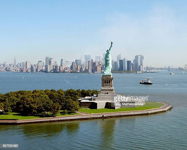 The Statue of Liberty with a view in the background of the Manhattan skyline without the World Trade Center.