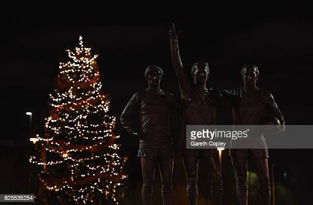 The statue of Manchester United legends Bobby Charlton Denis Law and George Best is seen prior to the UEFA Europa League Group A match between...