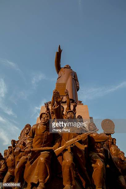 The statue of Mao zedong on Zhongshan Square is the largest one in china Around the base is the group statue of workers peasants and soldiers with...