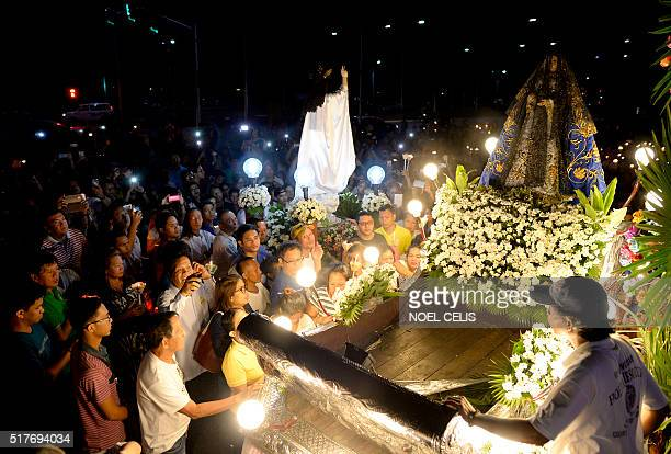 The statue of Mother Mary and Jesus Christ face each other during a mass in celebration of Easter Sunday outside the Malate Church in Manila to mark...