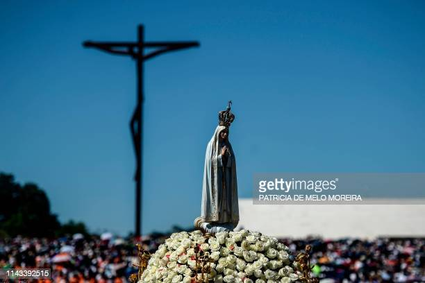 The statue of Our Lady Fatima is pictured during a procession at the Fatima shrine in Fatima, central Portugal, on May 13, 2019. - Thousands of...