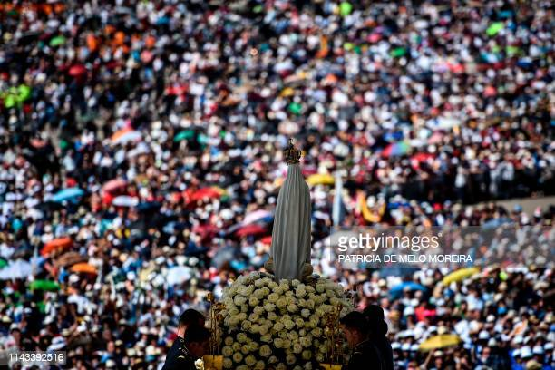 The statue of Our Lady Fatima is pictured during a procession at the Fatima shrine in Fatima central Portugal on May 13 2019 Thousands of pilgrims...