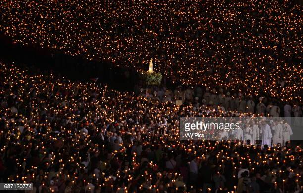 The statue of Our Lady of Fatima is carried by believers during the candle procession at the holy shrine of Fatima in central Portugal