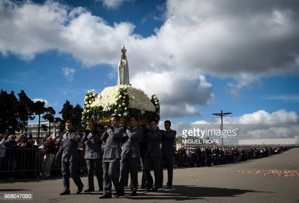 The statue of Our Lady of Fatima is carried during a mass ceremony at the Fatima shrine in Fatima central Portugal on May 13 2018 Thousands of...