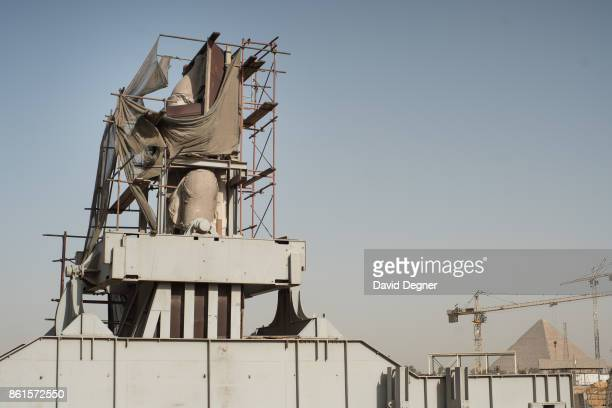 The statue of Rameses II stands in front of the construction site of the Grand Egyptian Museum stands at the edge of Giza on May 08 2017 in Cairo...
