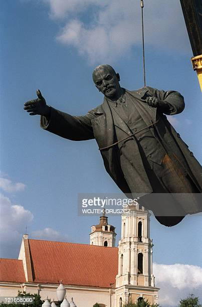 The statue of Russian Marxist revolutionary Vladimir Ilyich Lenin is dismantled 23 August 1991 in Vilnius the capital of Lithuania as the government...