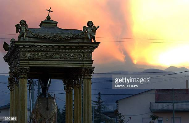 The statue of Saint Egidio the town's patron saint stands in front of Mount Etna October 30 2002 in Linguaglossa Italy A series of hearth quakes hit...
