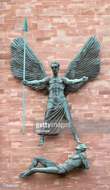 The statue of Saint Michael defeating Satan on the side of the new Coventry Cathedral