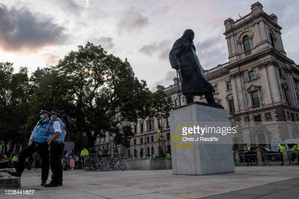 The statue of Sir Winston Churchill is seen vandalised with spray paint as an Extinction Rebellion protest takes place in Parliament Square on...