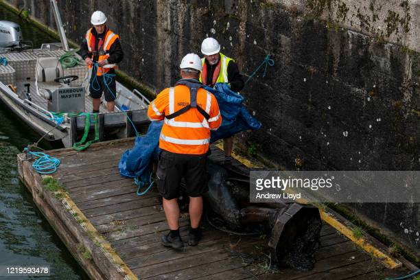 The statue of slave trader Edward Colston is retrieved from Bristol Harbour by a salvage team on June 11 2020 in Bristol England The statue was...