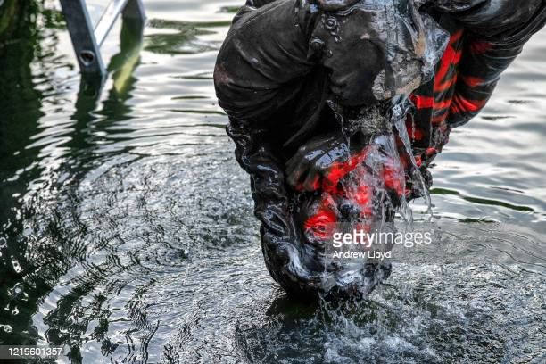 The statue of slave trader Edward Colston is retrieved from Bristol Harbour by a salvage team on June 11, 2020 in Bristol, England. The statue was...