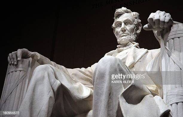 The statue of the 16th President of the US Abraham Lincoln is seen inside the Lincoln Memorial early on February 12 2009 in Washington DC The Abraham...