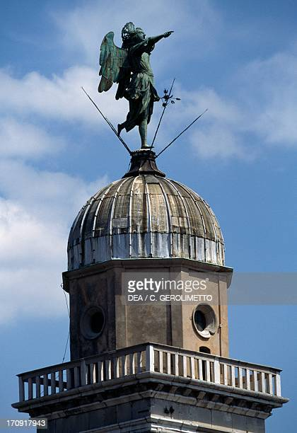 The statue of the Archangel Gabriel on the top of the bell tower Church of Santa Maria di Castello Udine FriuliVenezia Giulia Italy
