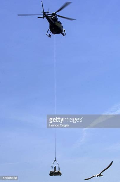 The statue of the Lady of Fatima arrives by helicopter to the St Peter's Basilica during a commemoration of 25th anniversary Pope John Paul II...