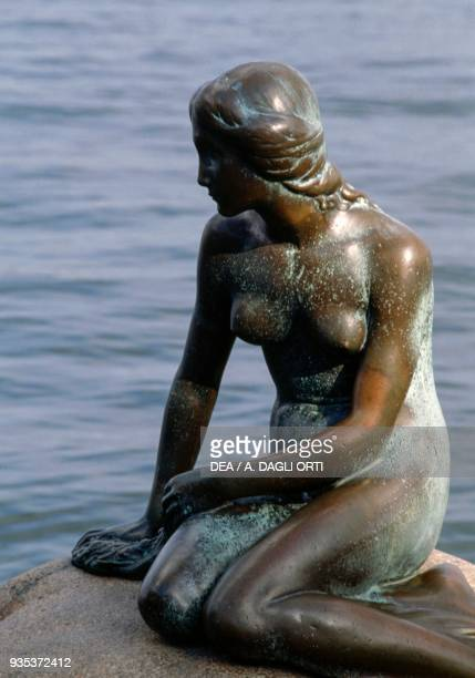 The statue of the Little Mermaid at the entrance to the harbour by Edward Eriksen Copenhagen Denmark Detail