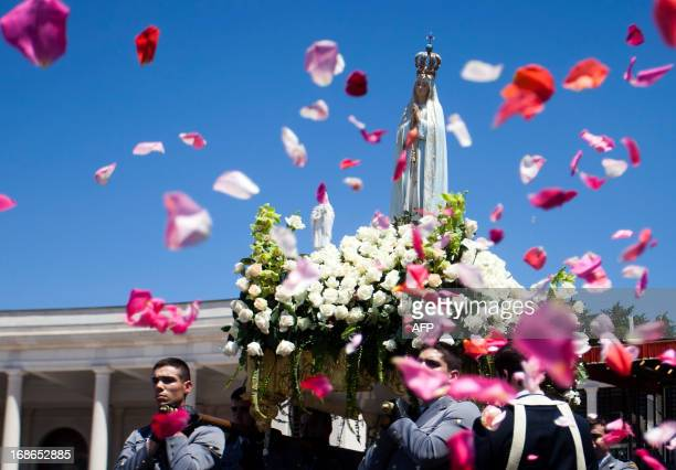The statue of the Our Lady of Fatima is carried during a mass ceremony at the Fatima catholic shrine in Fatima central Portugal on May 13 2013...