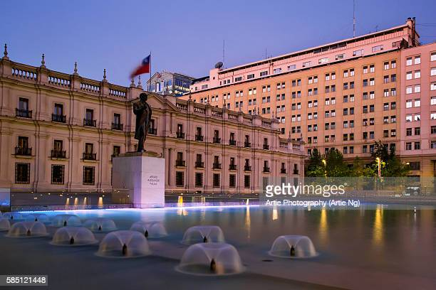 the statue of the president arturo alessandri at citizenry square with la moneda palace in the background, santiago, chile, south america - santiago chile stock pictures, royalty-free photos & images
