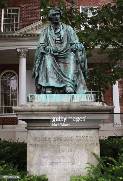 The statue of US Supreme Court Chief Justice Roger Brooke Taney sits in front of the Maryland State House on August 16 2017 in Annapolis Maryland...