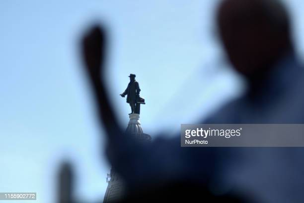 The statue of William Penn atop of Philadelphias City Hall is seen behind Sen Bernie Sanders as the presidential hopeful delivers a speech on...