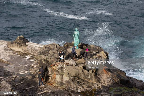 The statue on the shore Kopakonan which means the Seal Woman a mythological character known to all on the Faroe Islands seen on August 24 2018 in...
