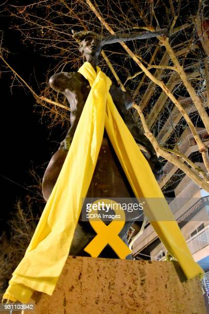 The statue The cosy symbol of the city of L´Hospitalet seen with a yellow ribbon aroung the neck during the protest Hundreds of people gathered in...