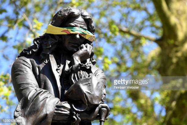 The statue to Edward Colston is seen with a blindfold on April 21 2020 in Bristol United Kingdom The British government has extended the lockdown...