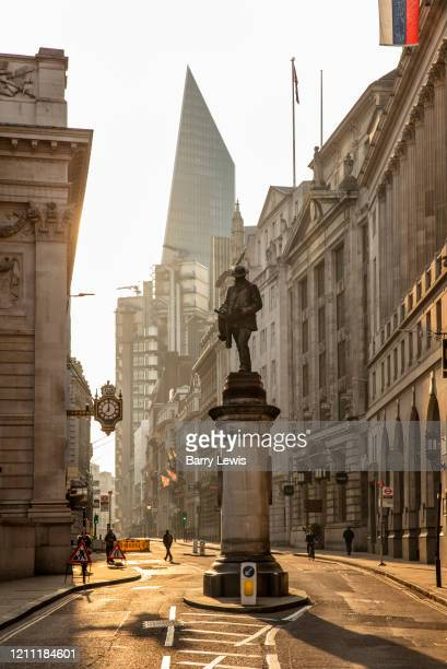 The statue to engineer James Henry Greathead inventor of the Greathead Shield on Cornhill in the City of London at 730am during the coronavirus...