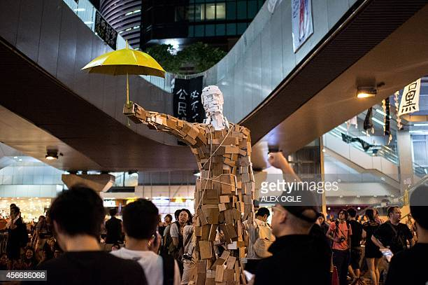 The statue Umbrella Man by the Hong Kong artist known as Milk is set up at a prodemocracy protest site next to the central government offices in Hong...