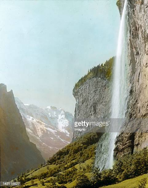 The Staubbachfall in Switzerland located in Lauterbrunnen cantone Berne Switzerland Hand colored lantern slide Around 1905