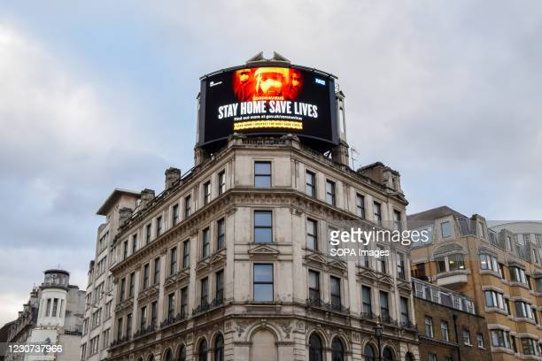The Stay Home, Save Lives billboard seen displayed in Central London. England remains under lockdown as the government battles to keep the...